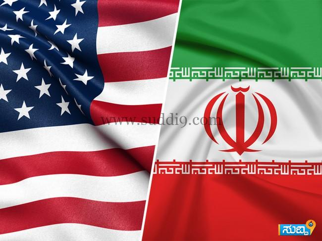 180606093823-us-iran-flags (1)